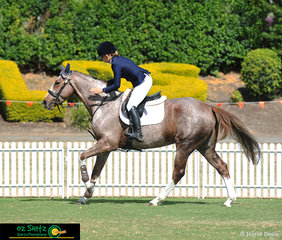 Very happy with their round, Alison Ostenfeld gives her 5 Year Old, Oh Argentum a big pat at the completion of the first round of the finals.