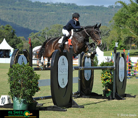 Flying over the final fence in the jump off in the 5 Year Old Horse Final was Madeline Sinderberry and Keilor Bamboo.