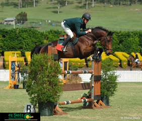 Chris Chugg brings Dundee Des Forets into the IRT arena to compete in the 1.15m Rising Star.