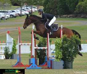 Storm Park Electric Blue clears the triple bar with ease  in the 1.15m Rising Star class with Anna Stenberg in the saddle.
