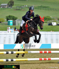 'Hold on!' Austin Brown riding his horse Stanton Park Houdini through the first phase of the 90cm childrens tour at Aquis Show Jumping Week 2