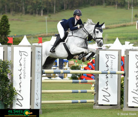 Stepping out in the Junior Tour 1st Qualifier in the main arena of the AQUIS Champions Tour was Tara Wilkinson and Harmony Hills Fabio.