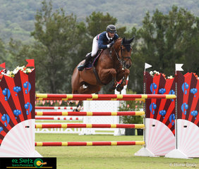 Oz Shotz sponsored rider Merrick Ubank flying through the Horse Power Gold Tour Jump Off riding Alantinus at Aquis Show Jumping Week 2