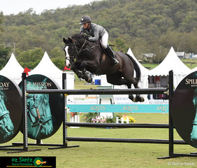 Maddison Stephen riding Black Currency and soaring over the Kolora Lodge Siver Tour Second Qualifier jumps at the Aquis Show Jumping competition 2019