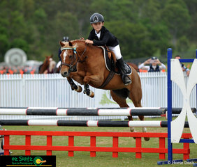 Showing us how it's done in the 80cm Two Phase Mini Tour for10yrs and under was Finnigan Bazzan on his pony Bundaleer Harmony taking away the first place win at Aquis Show Jumping 2019.