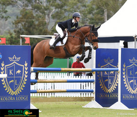 Jess Rice-Ward and Calinka S 2 fly over the Kolora Lodge oxer in the ISJ Junior Tour 2nd Qualifier at the 2019 AQUIS Champions Tour.
