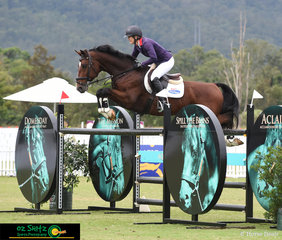 In the Kolora Lodge Silver Tour Final competitor, Vicki Roycroft flys over the jumps with Dynamite Bay at the AQUIS Champions Tour.