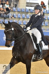 Sarah Farraway rode her own Arawn to second place in the Mulawa Performance FEI Grand Prix Freestyle under 25.