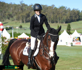 Big smiles for Olivia Hamood from Glen Haven Park as she completes her jump off round on Dada Des Brimbelles Z in the Bronze Tour Final,