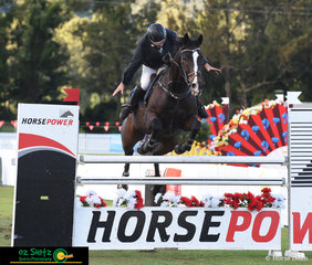 Would you expect anything less? - In true Ron Easey fashion and showing off to the crowd in the final class of the AQUIS Champions Tour Port O Call clears the final fence in the Speed Derby.