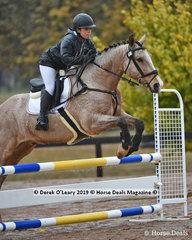 "Amelia Qvist in the EvA 80 Section B Showjumping riding ""Springwood Junior"""