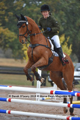 """Rachael Feely in the EvA 80 Section C riding """"Impian Just Ace"""""""