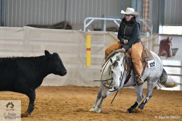 Kerry McFadden rode Presario to win the Amateur Senior Horse Ranch Cutting.