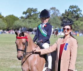Jett Newman was sashed Champion Junior Rider under 12 years, pictured with judge Eliza Babazogli.