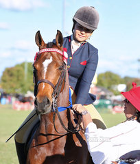"""Judge Jane Lavelle sashes the winner of the Novice Large Galloway class """"Gordon Park High Profile"""" ridden by Erinn Dickinson."""