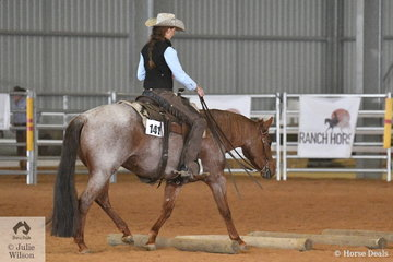 Jessica Oldham and Boot Smokin Boonie negotiate the poles well in the Open Senior Horse Ranch Trail.
