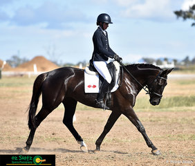 Riding a lovely and soft dressage test in the EvA95A is Olivia Barton on Hollyander HG at the Tamworth International One Day Event.