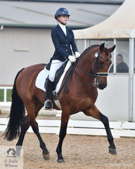 Olivia Gillespie rode, 'Versace' to take  second place in the Medium 4A test with 67.22%.