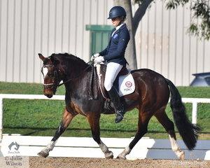 Sarah Broughton rode the charming, 'Barringa Alexander' to win the Pony Medium 4A test.