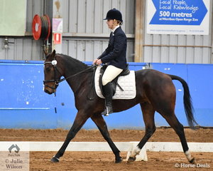 At the 25th Victorian Standardbred Dressage State Championship, Kate German rode Down River Road to take out the Novice Reserve Championship.