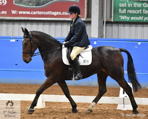 Cassandra Troon rode her ex-trotter Zinzan to second place in the Open Preliminary 1B State Championship. Zinzan is an impressive looking horse but his racing career statics are not so impressive with winnings of $63.