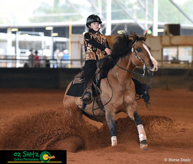 Sliding into first place in the Youth 13 and Under, alongside her sister who won the Youth 14 - 18, Ally Bogie and her horse Lil Shot prove their reining skills with an impressive sliding stop.