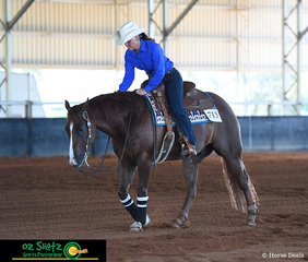 Kerri Behrens and My Dads A Wimp leave the pen with a score of 70 in the Horse 5 Years and Over Non Pro class at the Pacific Coast Reining Spectacular held in Gatton, QLD.