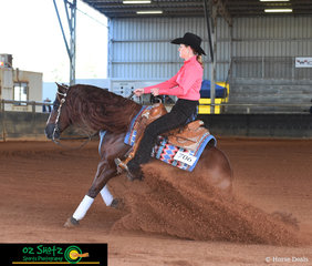 Sliding into Best Dressed Champion during the Lachlan Bell Memorial Ride at the Pacific Coast Reining Spectacular was Hayley Saunders and Hasta Shine.