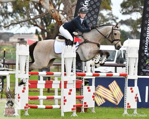 Emma Cumming and her, 'Just Reilly' are really looking on the job during their Off The Track CCI2*-L Junior showjumping round.  They lowered one rail and finished in third place.