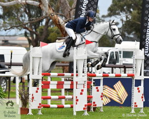 Oliver Barrett from NSW and a very attentive, 'Sandhills Special' finished on their dressage score to win the  Off The Track CCI2*-L Junior.