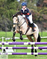 Lucy Coventry from Toorak College rode 'Wilde' to fourth place in the Level 3 Improvers Grand Prix.