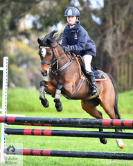 Alice Lawrence representing Toorak College riding 'Centre Stage Love' took third place in the Level 3 Improvers Grand Prix.