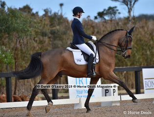 """Yarramee B Bear"" ridden by Hannah Shippen in the Advanced  5A, scoring 68.224%"
