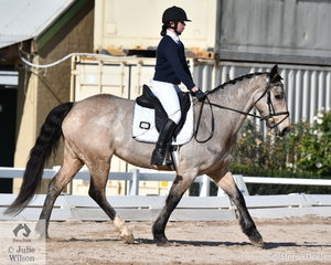 Georgia Barbic representing Assumption College Kilmore is pictured aboard her, 'Woolbrae Elegance' during their Preliminary Senior 1B test.