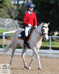 Theodora Newman representing Toorak College rode her, 'Flicka' to take third place in the Preliminary Primary 1C test.