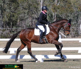 Against a picturesque background, Trudy Freeman and Fifth Element show off their extended canter in the One Star dressage test.