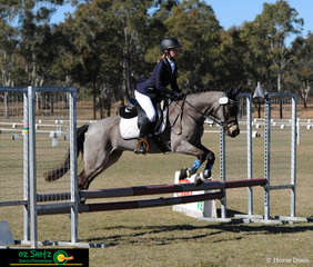 Flying over the oxer into the EvA60 show jumping, the first combination out were India Krattinger and Anian Warrior.