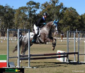 Brooke Dougall and Just Jazz cruise around the show jumping phase of the eenting 60cm at the Warwick Horse Trials held at Morgan Park.