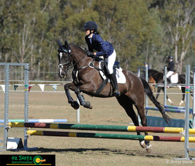 Making a nice shape over the 60cm fences was Remington Star with Natalie Tabb in the saddle.