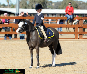 Cheered on from friends and family on the sideline, Harrison Galloway-Smith salutes at the end of his Year K - 3 Show Hunter Ridden phase aboard Bamborough Snigger.