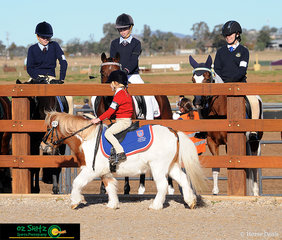 Supervised by her more experienced peers, Daisy Hemimg from Arndell Anglican College on her pony Jak Jak, in the under 7 gymkhana.