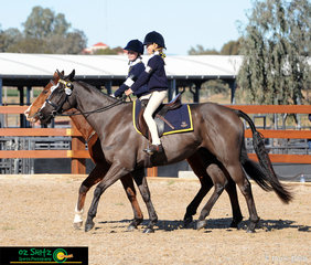 Paired up in the ring was Mikayla O'halloran and Emity Croft, with their dynamic duos' Rivoliroo and Rita in the 9 and Under 11 pairs Gymkhana at Interschool Horse Extravaganza 2019.