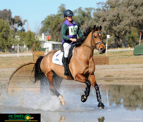 Flying through the water and approaching the next jump with confidence was Ella Silk in the One Star and her horse Go Theodorable.