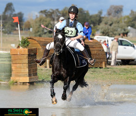 Giving her pony Amaranda Black Sambooka a little bit of extra motivation to get through the water in the EVA 60cm ODE was Madeline Henry at the Interschool Horse Extravaganza 2019.