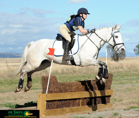 Jumping the Ditch Palisade with ease in the EvA60 was Caitlin Biddle and her horse Ballinton Summer Lady.