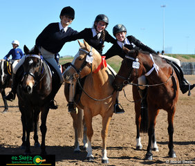 Best of pals show excellent sportsmanship were Emily Walklate on Fairway Serenade (left), Emily White and Goldie (centre) and Jade Attard riding Lucy (right) after their gymkhana presentation.
