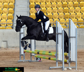 MP Too Eze and Ella Bourke fly effortlessly over jump number 3 in the CT 60cm