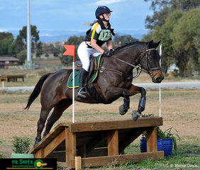 Looking straight ahead over the ramp in the EvA80 cross country phase of the eventing was Phoebe Heath and Rye Wonder.