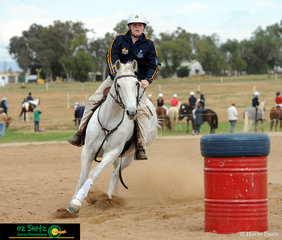 Going full speed ahead around the barrels was Toby Mather and his happy horse Riverdaire Ebony.