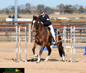 Approaching their final obstacle in the Working Horse Challenge was Chloe Underwood riding her horse Oasis Bud Bunndy.